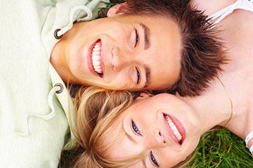 Portrait of a smiling couple lying in the grass